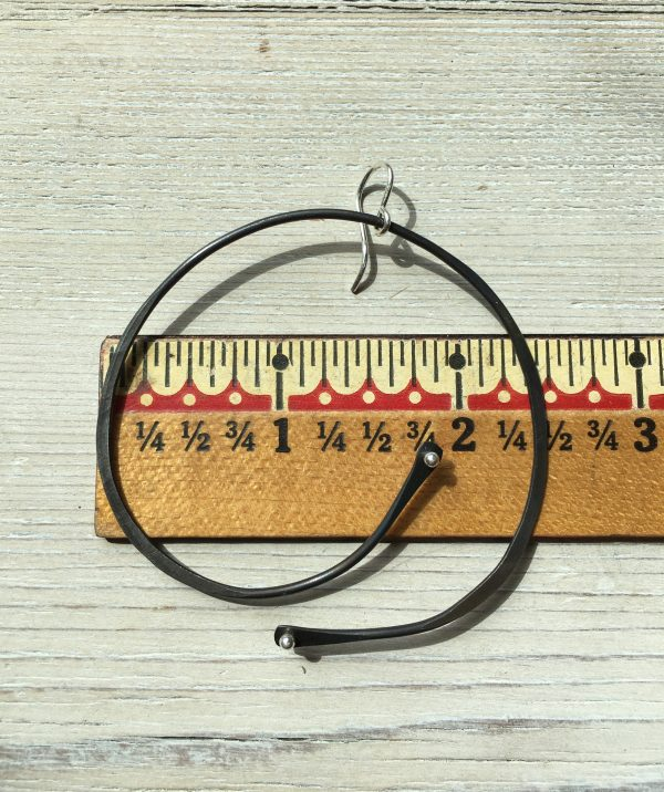 ruler with one earring to show size