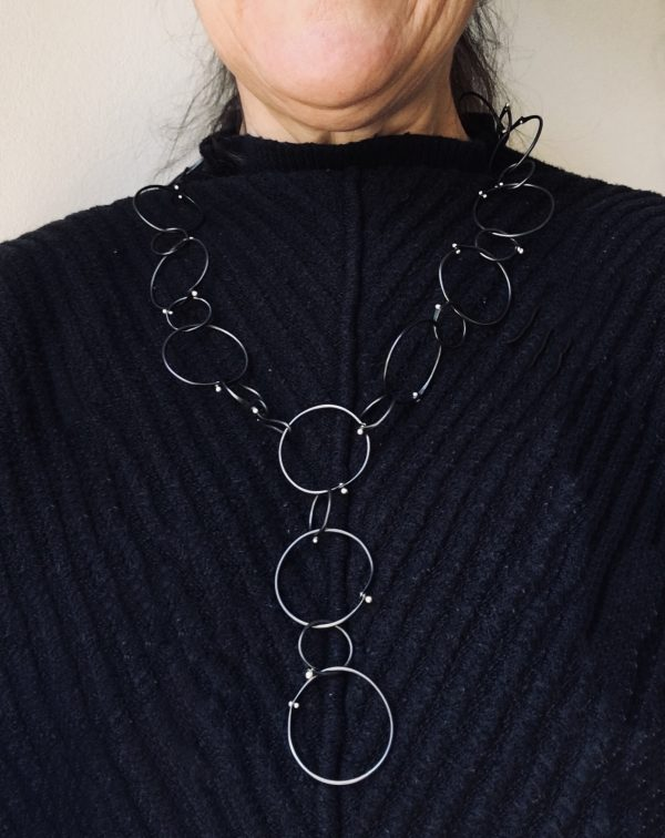 adjustable circle necklace on model