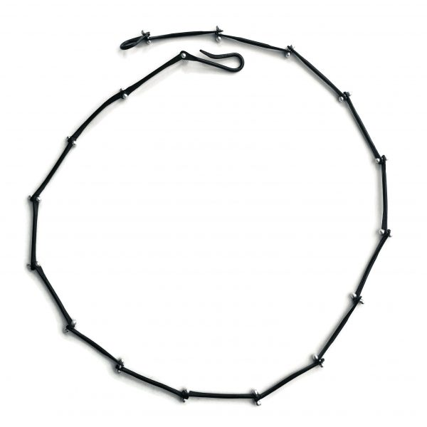 black necklaces with increments or segmants