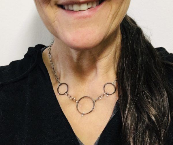 three circles necklace, black and silver on model