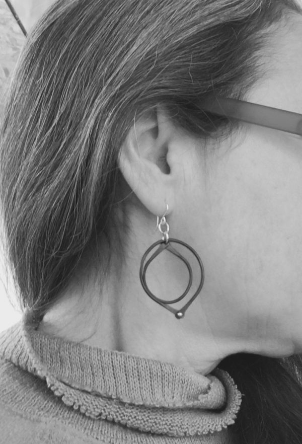 black dangle earrings on model