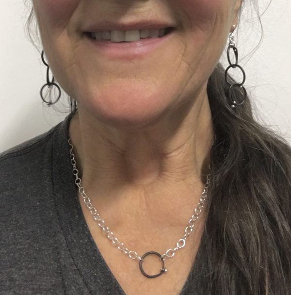 black and silver necklace on model